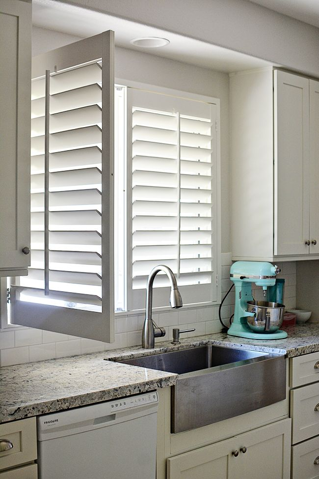 "A turquoise Kitchenaid and fab blinds appear to be the perfect mix! Our customer said ""Can you tell that I am loving all of the brightness these plantation shutters bring into our home? It makes such a drastic difference."""