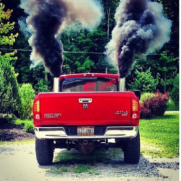 Red Dodge Ram Cummins Diesel Truck Rolling Coal