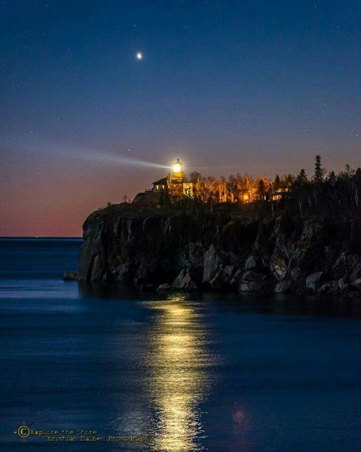 On the 41st anniversary of the sinking of the Edmund Fitzgerald, 11/10/2016, Split Rock Lighthouse was lit.  Above the lighthouse, Venus looks like a brilliant star.    © Christian Dalbec. Used with permission. See more at www.facebook.com/ChristianDalbecPhotography