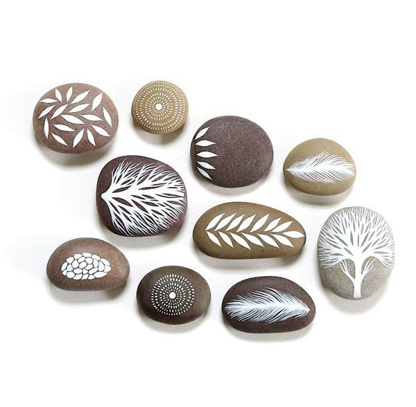 Here's another set of those beautiful white painted drawings on these brown rocks. It's simply a work of art.