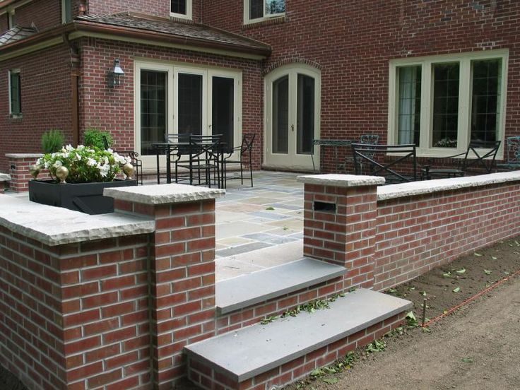 Brick Wall To Match The House And Edan Stone Cap Frameing Bluestone Patio  By Kevin Laufenberg