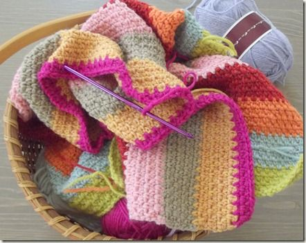 """This blanket is in woven stitch, also sometimes called """"linen stitch"""", which is just sc, ch1 across, and then on the next row, sc in the ch1 space, ch1. It's the easiest thing in the world, and I'm left with nothing at all to concentrate on except which color comes next. I love that."""