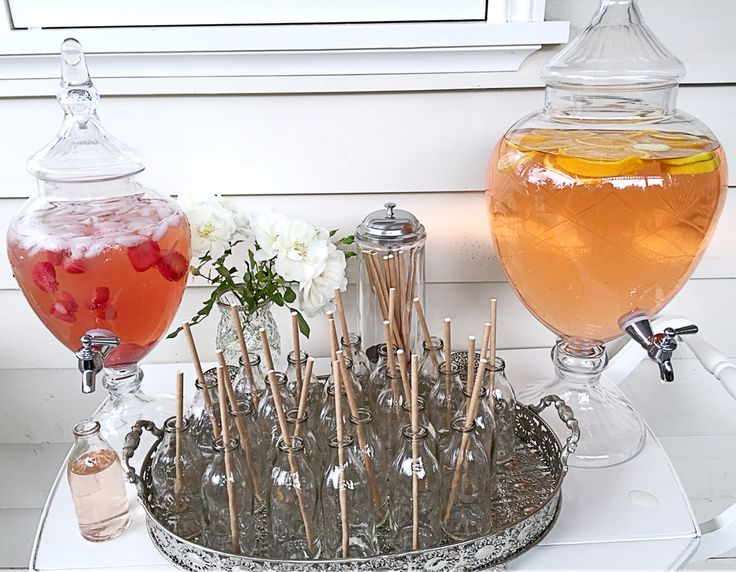 Fruit cocktails from the etched glass drink dispensers