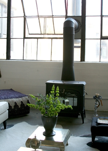 Alina's home. wood stove, large windows, moroccan touches, low metal tables