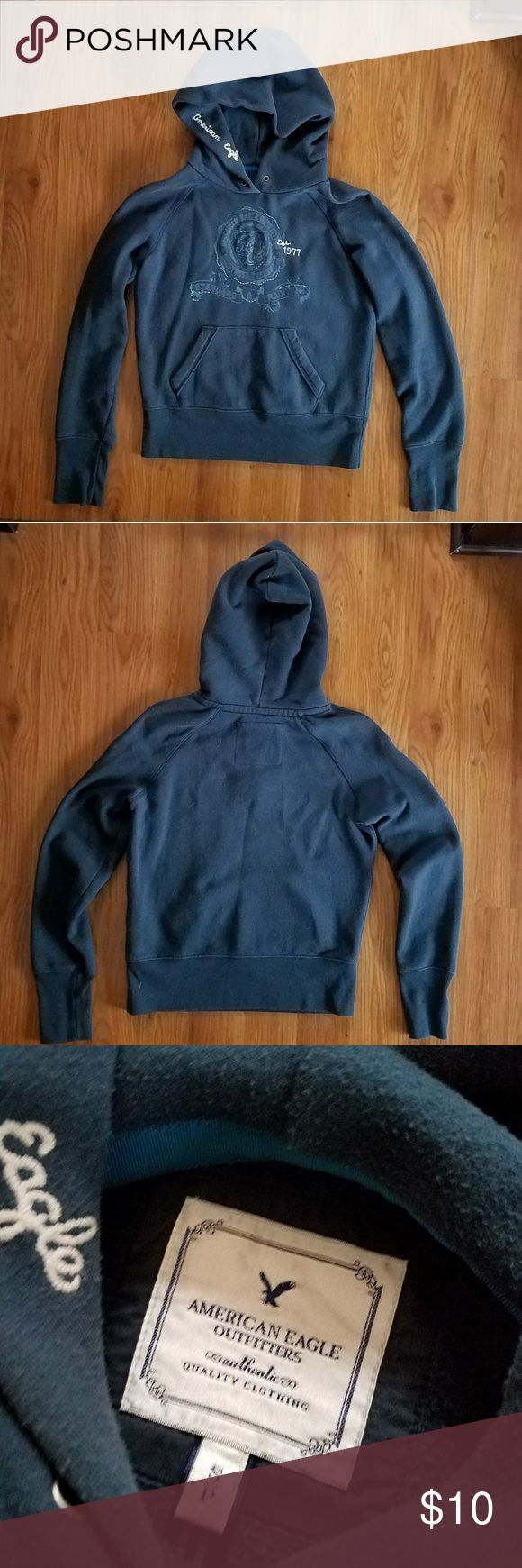 American Eagle navy blue hoodie Navy blue hoodie with contrasting blue design/lettering on front. Embroidered American Eagle in white on inside of hood. Drawstring missing but otherwise in great shape. American Eagle Outfitters Tops Sweatshirts & Hoodies