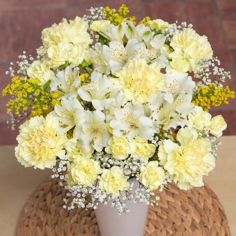#Bunches.co.uk Sunshine Bouquet L FSUNEL #A beautiful bouquet which celebrates the bright colours of the summer season. Yellow Carnations and white Alstroemeria are accompanied by sunny yellow Solidago and pretty white Gypsophila.