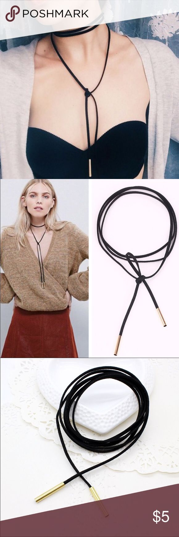 """Black & Gold Long Cord Bow Knot Choker Necklace Black & Gold Long """"Leather"""" Cord Bow Knot Choker Necklace. This is NOT real leather - I will not advertise / sell real leather in my closet.  This Necklace is approximately 59 inches long. ❤️ONLY 6 AVAILABLE❤️ ✨Price is firm unless bundled✨ Jewelry Necklaces"""