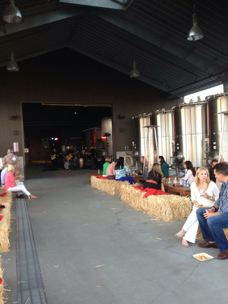 Wine, food and friends on the winery crush pad at Round Pond Estate's Summer Solstice Party.