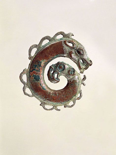 Coiled Animal (applique)    Bronze  W: 4.68-5.65 cm  Provenance: no indication  Central Siberia, Tagar Culture II  5th-4th century B.C.