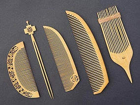 A set of Japanese tsuge(boxwood)combs with delicate cuts, ca 1950, never been used.