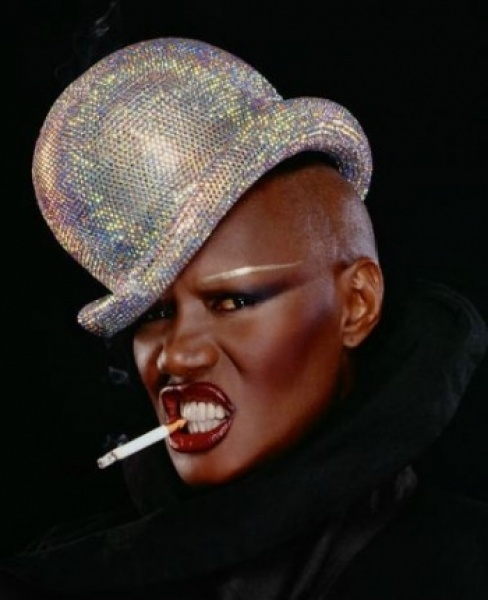 Grace Jones wear's her iconic disco ball bowler hat by Jean Paul Goude - pinned by RokStarroad.com ~ unleash your inner RokStar - fashion, pop and mental health