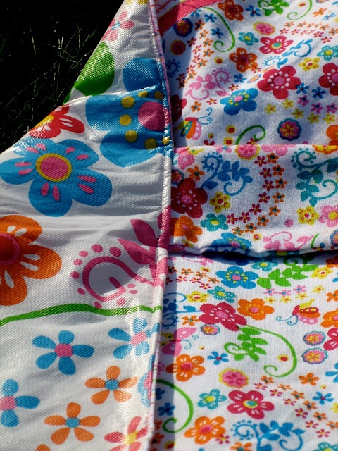 A little cute DIY for the waterproof beach/park blanket...two tablecloths, one vinyl and one cloth. Update: wait for end of summer clearance and sew two x two...two fabric and two vinyl.