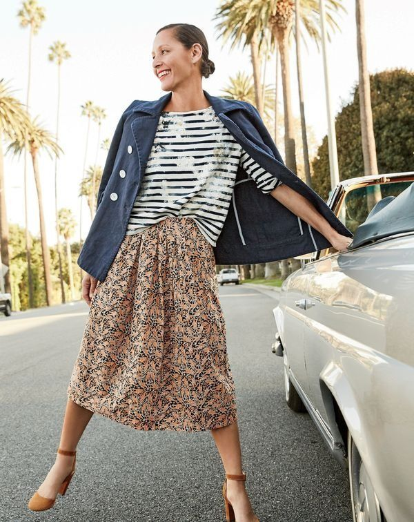 J.Crew women's cotton peacoat, limited-edition long-sleeve sailor stipe T-shirt in paint splatter, Drake's®️️ for J.Crew skirt in giraffe print and Lena ankle-wrap pumps in suede.
