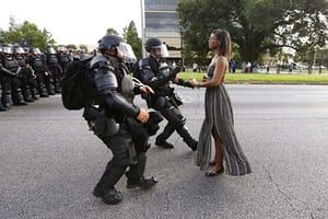 Ieshia Evans and riot police during a protest against police brutality at the Baton Rouge police department in Louisiana on 9 July, 2016.