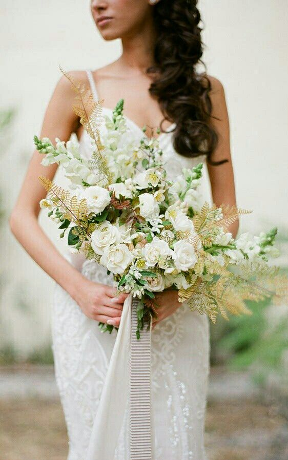 Gorgeous Bridal Bouquet Which Features Some Of The Following: White Tea Roses, White Snapdragons, White Tweedia, Tuberose & Additional Coordinating Florals & Foliages