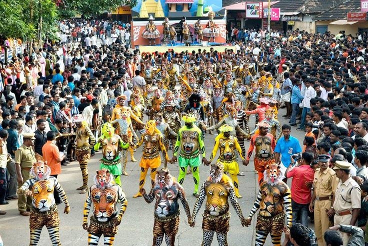 """Puli kali"" (Tiger Dance), a traditional Kerala art form held in Swaraj Round, Thrissur during the month of September, marks the official ending of Onam celebration in Kerala. Decked in full body paint and masks, the participants of Pulikali dance to the beat of the drums. The make-up process is meticulous and tends to last five to seven hours. These human tigers and the hunters who follow them transform Swaraj Round into a photographer's dream."