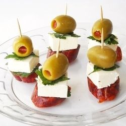Skewers, a simple and colorful appetizer. Spanish olives with Mozzarella and pepperoni
