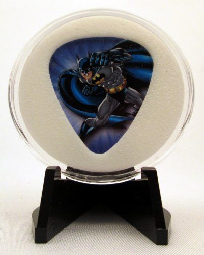 "DC Comics ""Batman"" Guitar Pick With Display Case & Easel - 100% MADE IN USA! Contains an officially licensed guitar pick. The white material is produced from a cross linked polyethylene, which is a plastic material. Unique item. Side B: Peavey logo. Guitar Pick Description: Officially licensed pick by Peavey. All components are 100% Made In USA! Of course you can open the acrylic case and remove the pick! The holder is manufactured through the process of injection molding using..."
