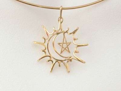 """Sun/moon/star'' wire pendant"
