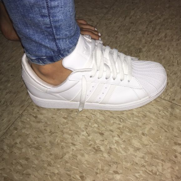 All white Adidas Brand new never worn all white adidas. Size 5.5 Boys Adidas Shoes Sneakers