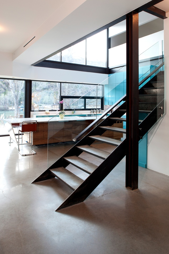 Modern kitchen and stairs in lakeside house in Texas