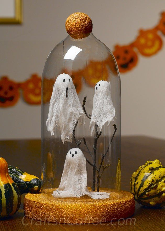 Three itty bitty Cheesecloth Ghosts decorate this Halloween Cloche. Adorable! And, the cloche is made from a repurposed plastic soda…