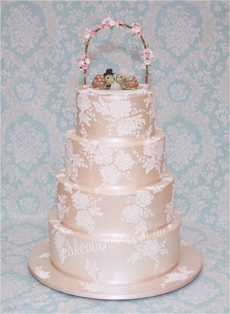Champagne coloured wedding cake with brush embroidery and