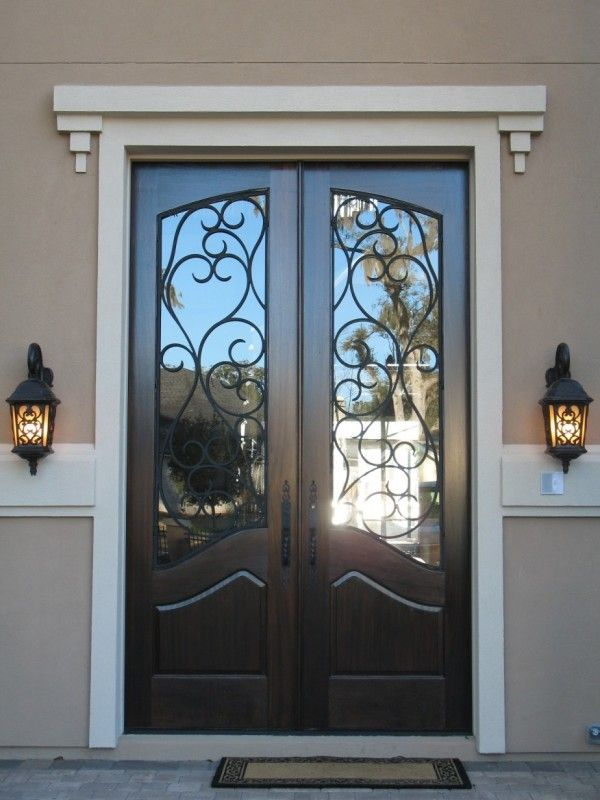 decoration inspiring black double entry doors with wrought iron glass inserts and white crown molding also oil rubbed bronze lever handles alongside antique wall lantern outdoor