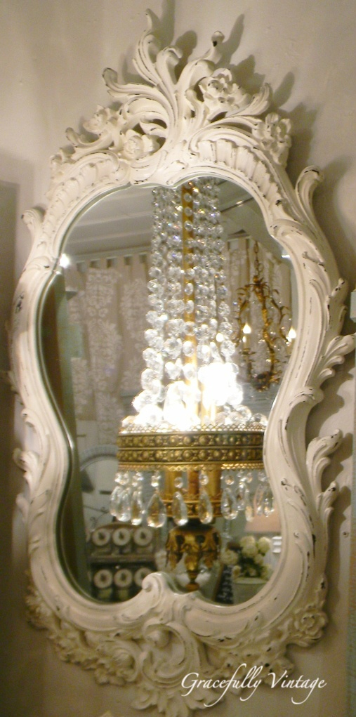 Pretty Reflection. Two of my favorite things~ornate mirrors and chandeliers!