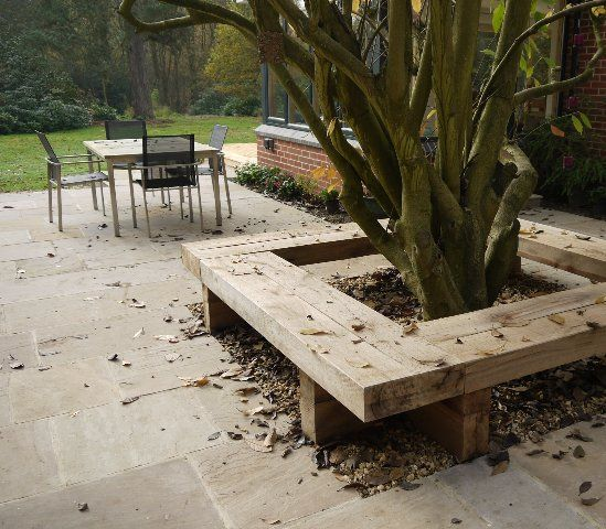 Lovely tree trunks and like the solid seating a lot.  Garden Elements - Andrea Newell Garden Design