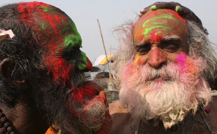 Holi - Indian Festival of Colors, welcoming Springtime. Sadhus or holy men with painted faces sing songs as they celebrate Holi on banks of the Ganga in the northern Indian city of Allahabad March 11, 2009. (REUTERS/Jitendra Prakash) #