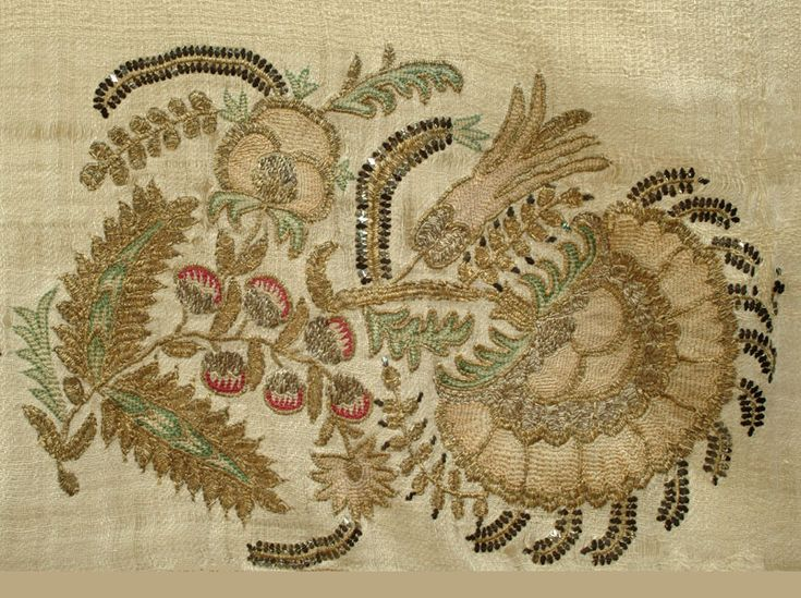 A linen towel with two silk and metal embroidered borders each comprising three bouquets.