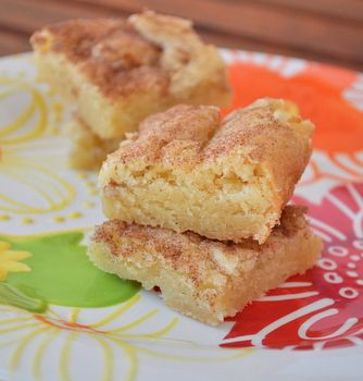Snickerdoodles are a classic American cookie, a bake-sale staple. They're essentially sugar cookies that have been rolled in cinnamon sugar before baking, which gives them a crisp and flavorful crust to contrast a moist, sweet interior
