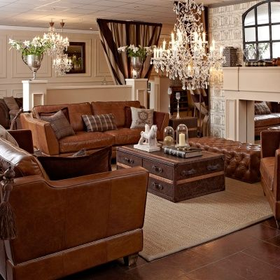 Totally loving a cognac colour for a couch!! I like the throw pillows and coffee table too!