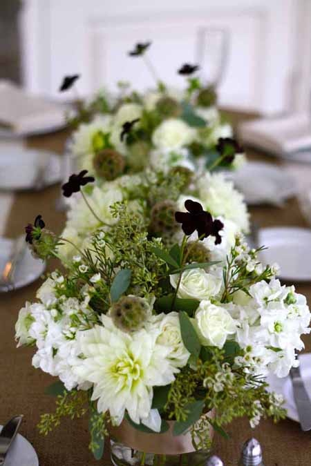 White dahlia and stock with chocolate cosmos and scabiosa pods flower centerpieces by Sebesta Floral Design