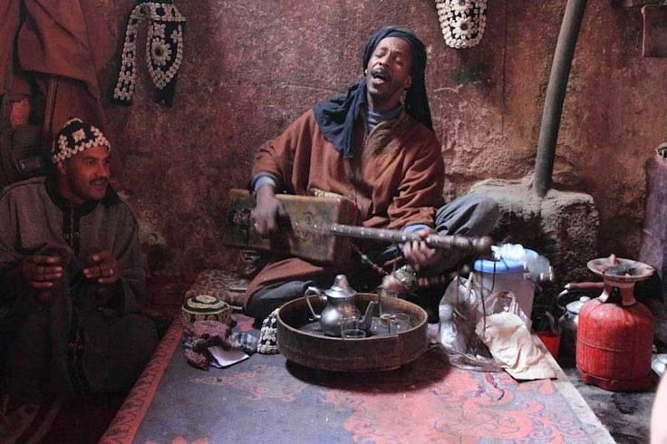 Gnawa Maalem of Morocco playing the Guembri instrument.