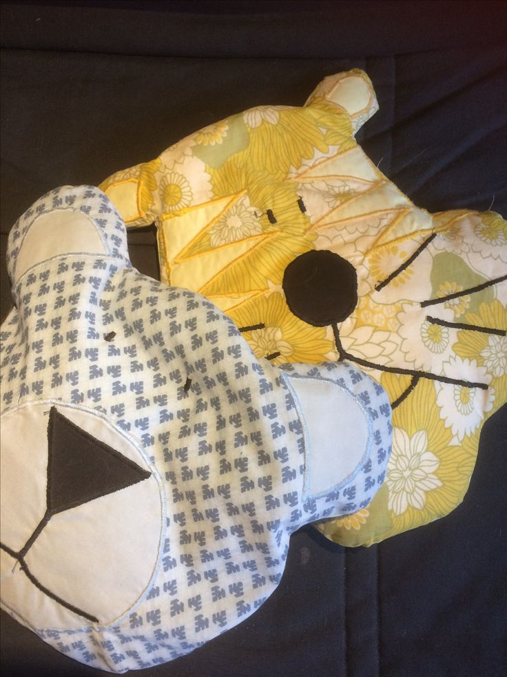 Bear and tiger cushions.