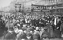 Putilov workers protesting in the streets. At the beginning of February, Petrograd workers began several strikes and demonstrations. On 7 March [O.S. 22 February], workers at Putilov, Petrograd's largest industrial plant, announced a strike.Although some clashes with the Tsar's forces did occur, no one was injured on the opening day. The strikers were fired, and some shops closed, resulting in further unrest at other plants