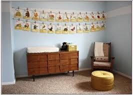 Decorating the Nursery on a tight budget?  A second hand sideboard can be great for storage and double as a nappy changing mat holder.  Wall decorations are of Alphabet pictures made by you from pictures in old magazines.  The baby stage does not last long, so you can quickly covert the blue painted walls into a young child's room with minimal cost.