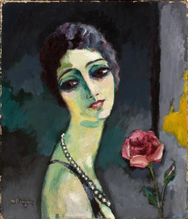 Kees Van Dongen (Delfshaven, 1877 - Monaco, 1968) Portrait de Madeleine Grey à la rose  Huile sur toile signée 'Van Dongen' en bas à gauche, datée sur le châssis : '1929'  Inscrite sur le châssis et au dos de la toile 'Alexandrie'. 55 x 47 cm  Estimation : 200 000 € - 300 000 €
