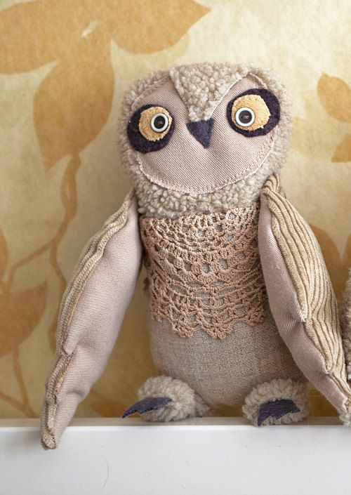 Owly owl is a vintageminded and old times soul creation. She have movable wings, fixed with the buttons. Her chest is decorated with crocheted tea dyed doily. ~I want a tutorial on how to make him! This would be a fun project.