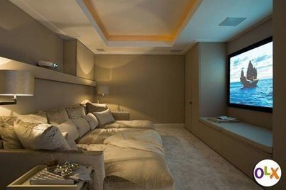 Maybe THIS is a bit excessive, but the idea is decent; large couches, lots of pillow, which could certainly double as a guests bed. My main concern with small homes is entertaining without compromise. Like.