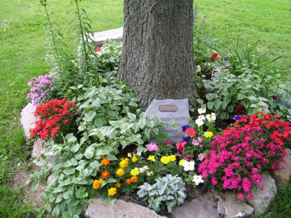 markers for roses and other blooms call attention to the memorial garden