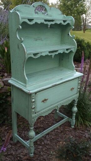 Small vintage step back hutch with scalloped sides in turquoise chalk paint.