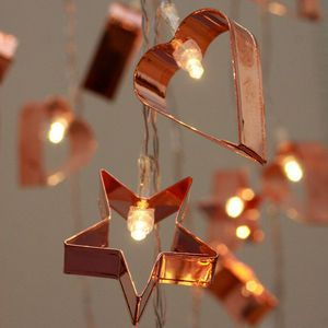 "Copper Cookie Cutter String Lights | Introducing #Hygge – our favourite new excuse to snuggle under a chunky knit with a cup of cocoa. Pronounced ""hooga"", this Danish trend is all about embracing cosiness and enjoying the good things in life surrounded by your favourite people. That definitely sounds like something we can get on board with."