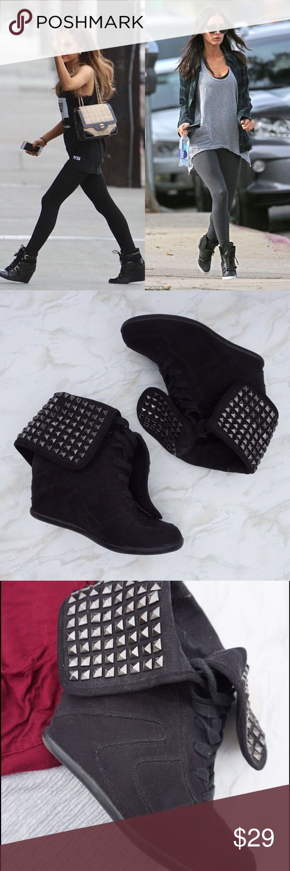 Call It Spring Black Studded Wedge Sneakers If it's good enough for Ariana Grande and Megan Fox, it's good enough for me! 🔥 These studded wedge sneakers are so on trend right now! They go with leggings, jeans, shorts, skirts, pretty much everything in your closet! Wedge heel makes them super comfortable and makes your legs look miles long. I wish I could keep them but my feet grew when I was pregnant and now they're too small!😭 In great condition, only missing one bracket as shown in the…