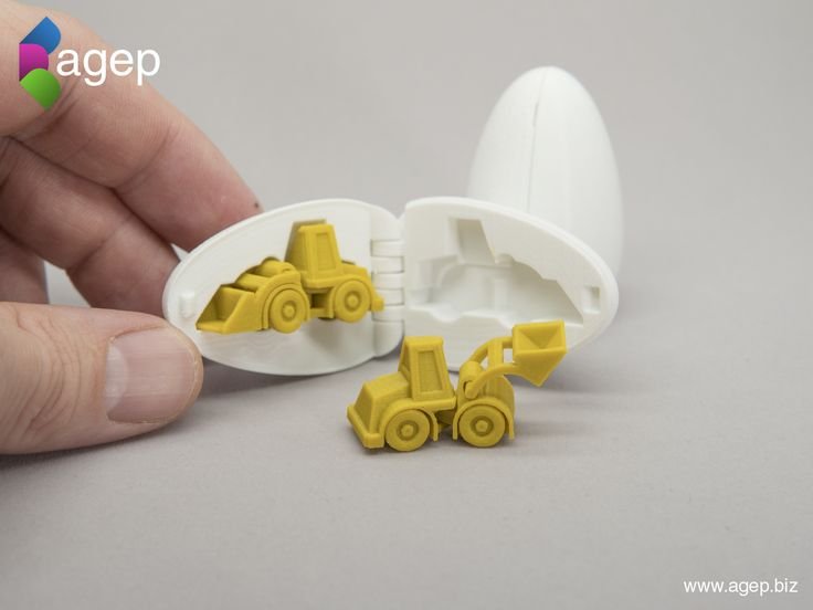 3D Printable Surprise Egg No3 - Tiny Wheel Loader Toy Stresstest your 3D Printer by downloading and printing this tiny collectible stocking stuffer for free!  Both the wheel loader and the egg was each designed to be printed in place without any support structures. The wheel loader has rotatable wheels, liftable loader bucket and articulated steering apparatus. The egg is hinged