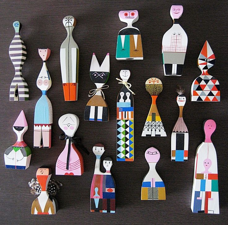 Made by Vitra, wooden painted dolls by Alexander Girard