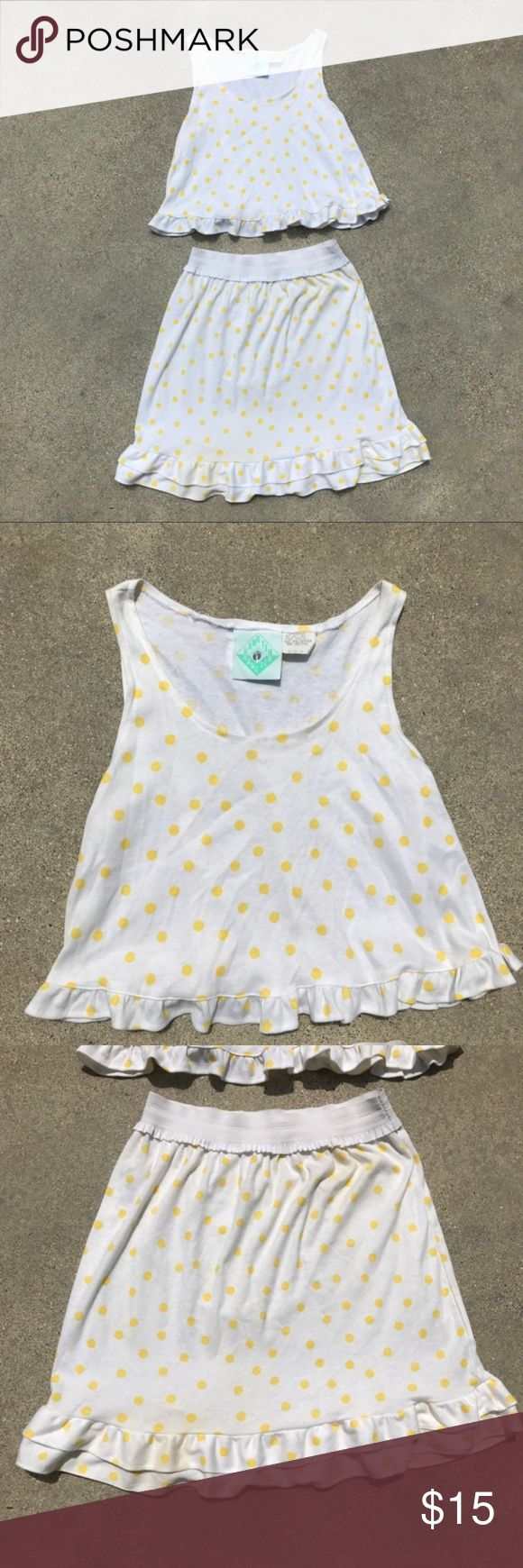 Vintage Hang Ten Polka Dot Top/Skirt Set Adorable yellow polka dot vintage Hang Ten tank top/skirt set. Top is size medium, skirt is size large. The skirt has an elastic waistband, allowing for a lot of give. Good vintage condition with only flaws being a light stain on the skirt as pictured in the last image which is not noticeable when worn and a few places with loose stitching. Measurements are as follows: Top:  Pit to pit: 18 inches Shoulder to hem: 18 inches  Skirt: Waist: 25 inches…