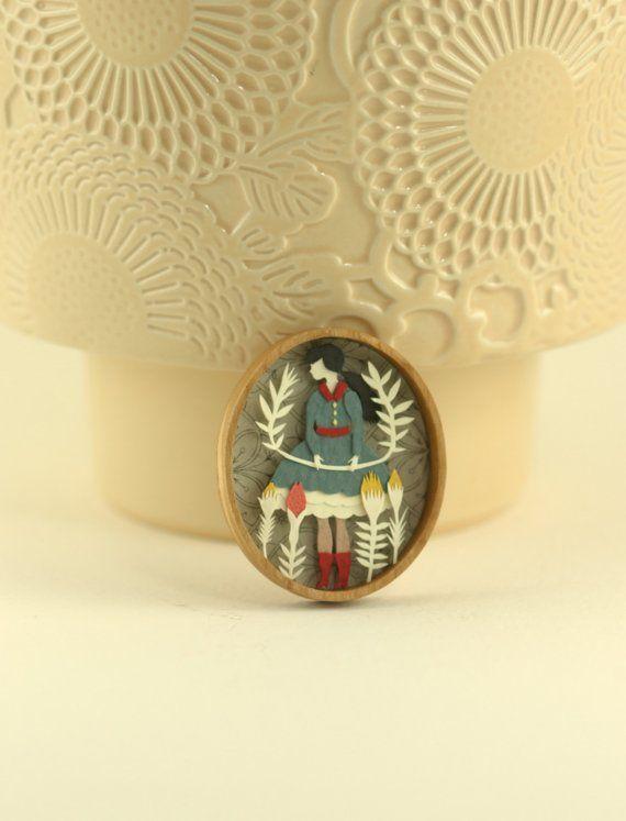 Miniature papercut scene in wooden bezel by Elsa Mora